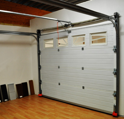 Porte de garage sur mesure sectionnelle ou enroulable for Porte de garage sur mesure castorama